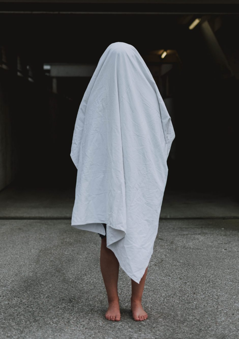 Person covered with a white sheet