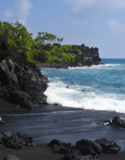 Black sand beach in Wai'anapanapa State Park along the famous road to Hana on Maui, Hawaii.